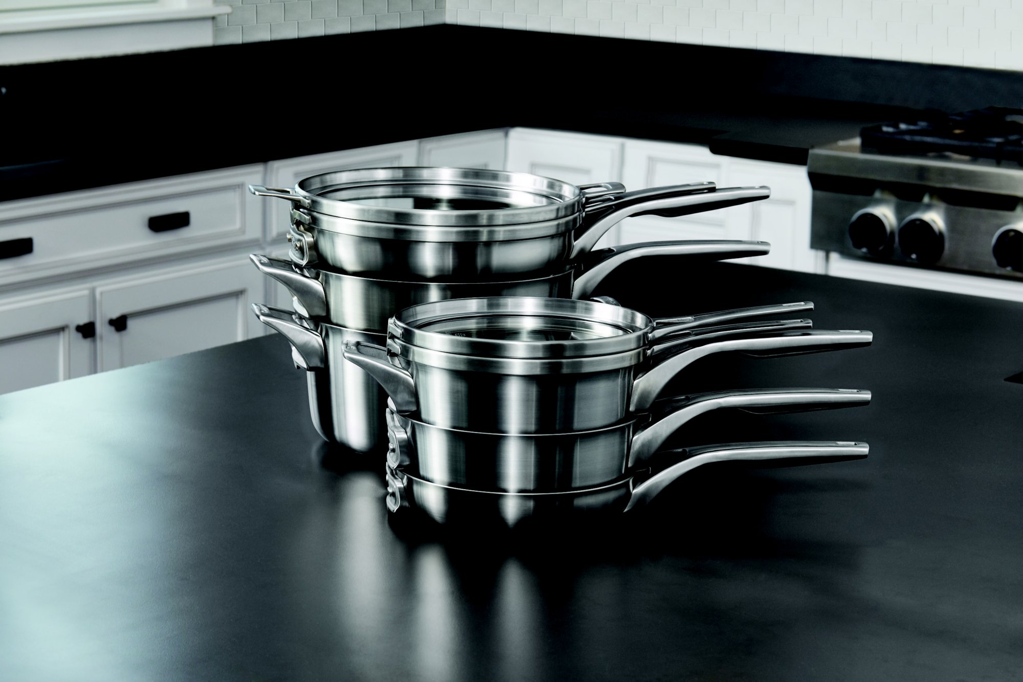 calphalon premier space saving stainless steel cookware securely stacks to save 30 more space plus the unique cookware design and flat glass covers